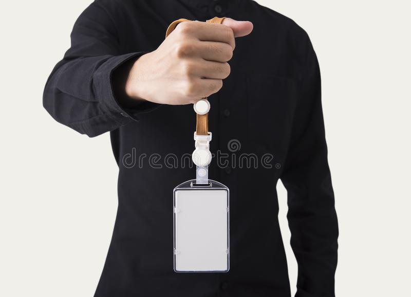 employee hand showing blank id name card badge holder for mockup template logo branding background. stock image