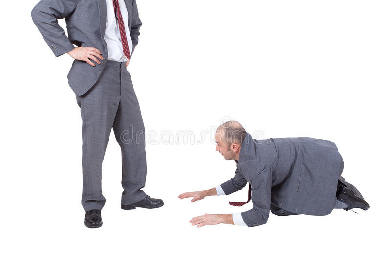 Employee begging his boss stock photo