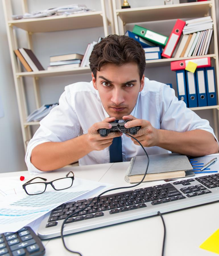 Employee playing computer games in the office. The employee playing computer games in the office royalty free stock photos
