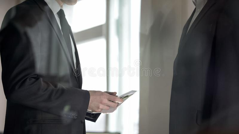 Employee receiving salary in envelope, tax evasion, kickback in illegal deal. Stock photo stock images