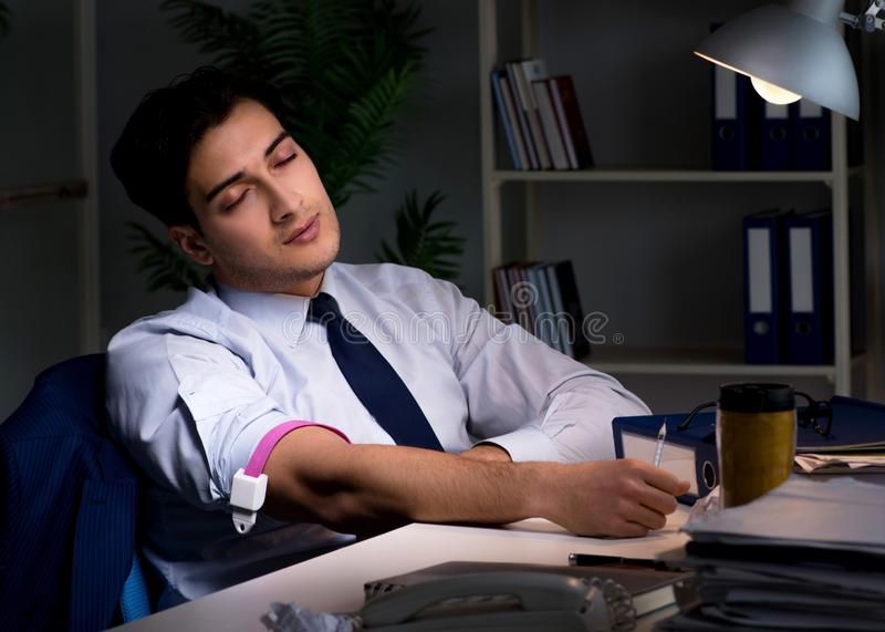 The employee relieving stress from overtime with drugs narcotics royalty free stock photography