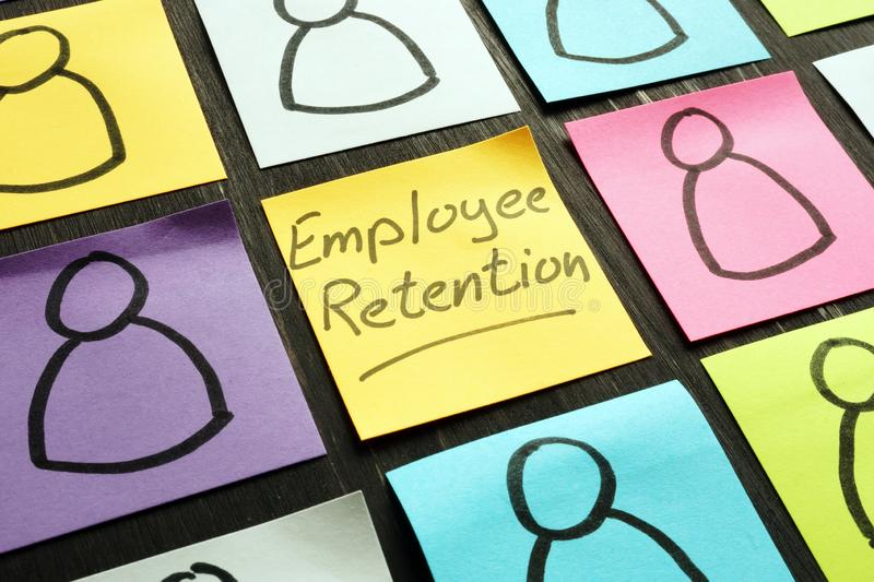 Employee retention sign and figures on the memo sticks. Employee retention sign and figurines on the memo sticks stock photography