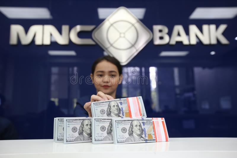 United States dollar. The employee shows the United States dollar at MNC Bank, Jakarta, Indonesia royalty free stock photography