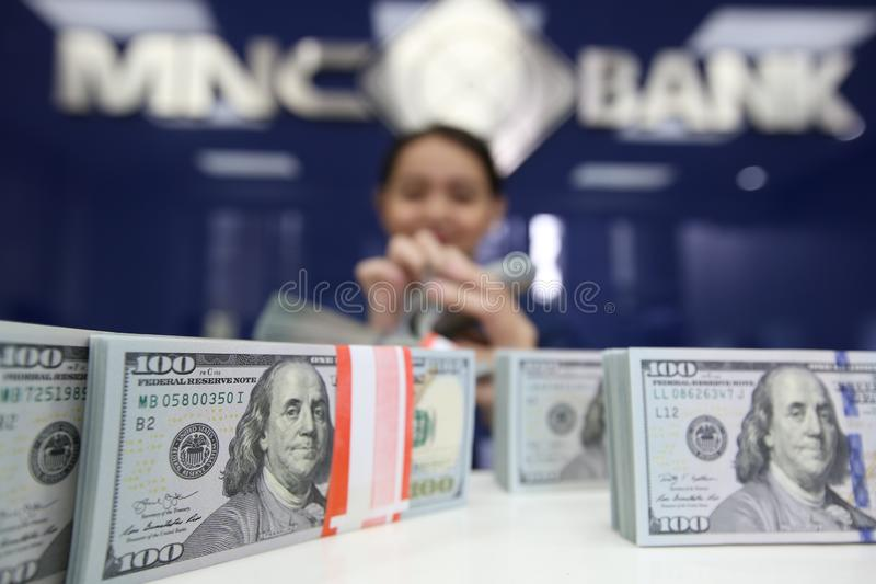 United States dollar. The employee shows the United States dollar at MNC Bank, Jakarta, Indonesia royalty free stock images