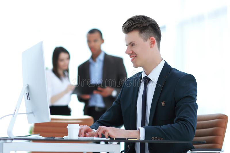 Employee sitting behind a Desk in the office . Photo with copy space royalty free stock photos