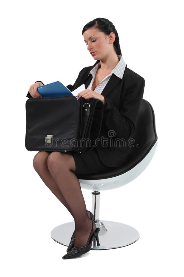 Employee sitting on a chair. Smart employee sitting on a chair royalty free stock image