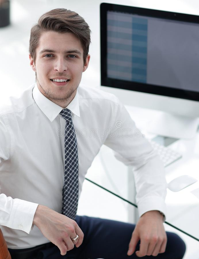 Employee sitting in front of a computer screen. Successful employee sitting in front of a computer screen.photo with copy space stock images