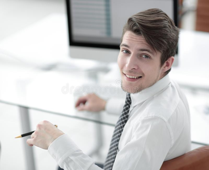 Employee,sitting in front of the laptop. Successful young employee,sitting in front of the laptop .photo with copy space royalty free stock photo