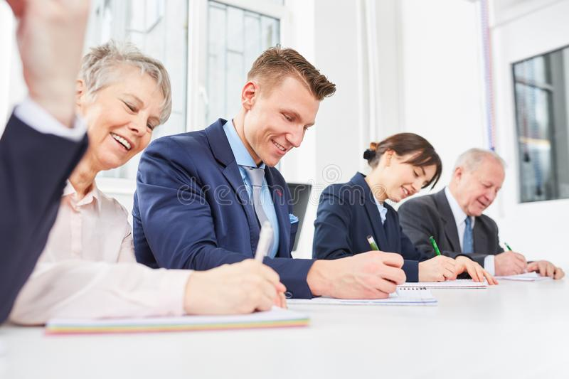 Employee staff in training taking test. Employee staff in training taking qualification test in assessment center royalty free stock images