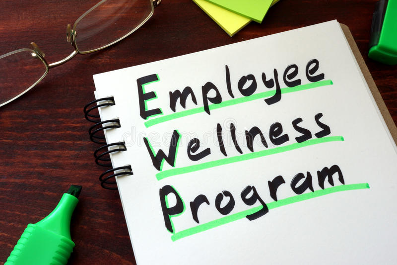 Employee Wellness program. Written on a notepad with marker stock photography