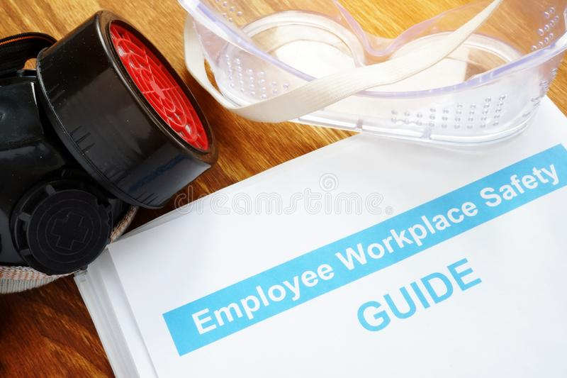 Employee Workplace Safety guide on desk royalty free stock photography