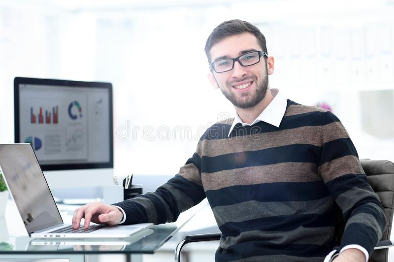 Employee works with marketing schemes. Sitting at your Desk stock image