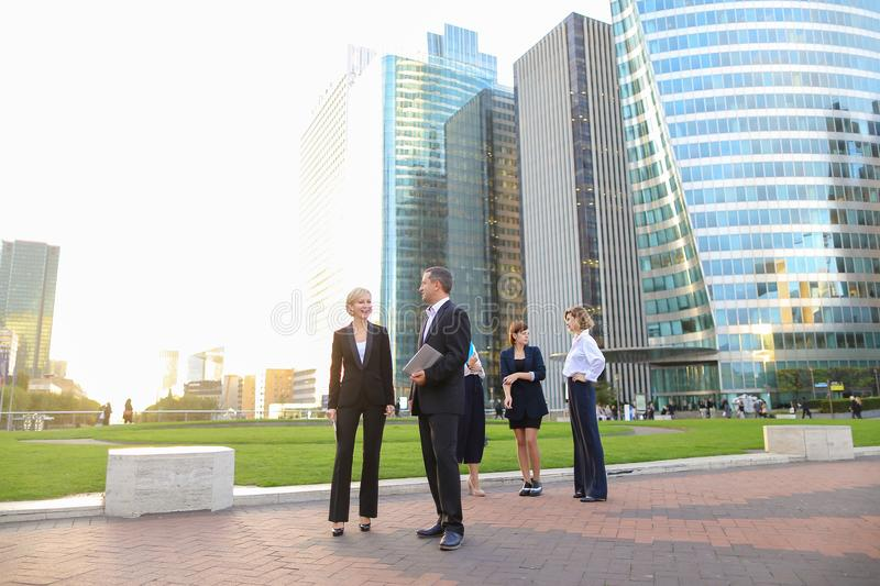 Employees of business organization talking in La Defense Paris w royalty free stock photography