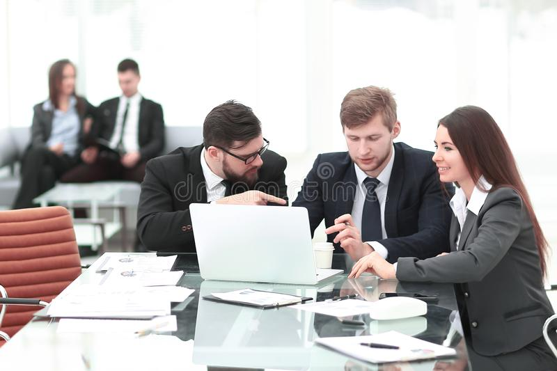 Employees of the company discussing with the client the terms of the contract royalty free stock photography
