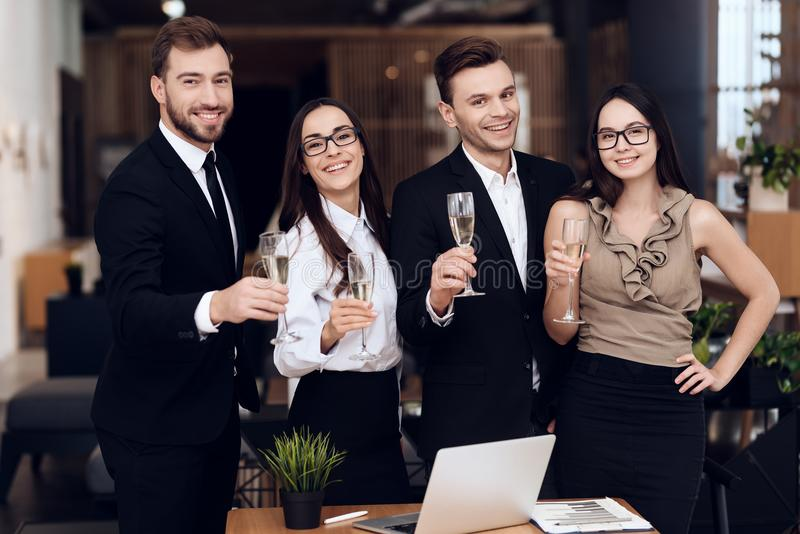 Employees of the company drink alcoholic beverages after a business meeting. stock photo