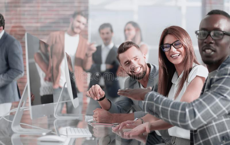Employees of the company hold a briefing in the office royalty free stock photography
