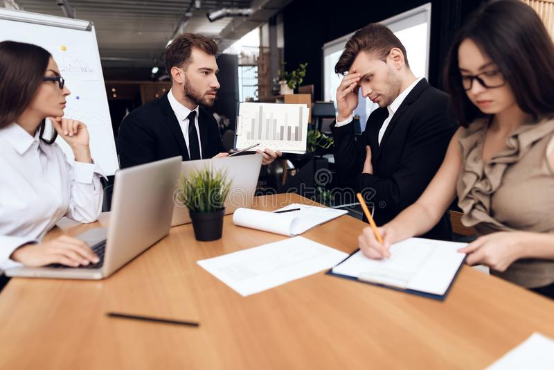 Employees of the company hold a meeting at the table. stock photography