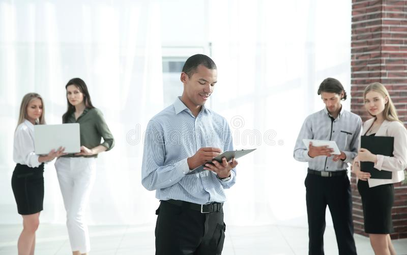 Employees of the company before the meeting, standing in the lobby of the office royalty free stock image