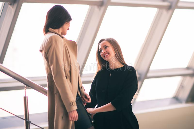 Employees of the company talk in the spacious hall of the office royalty free stock photos