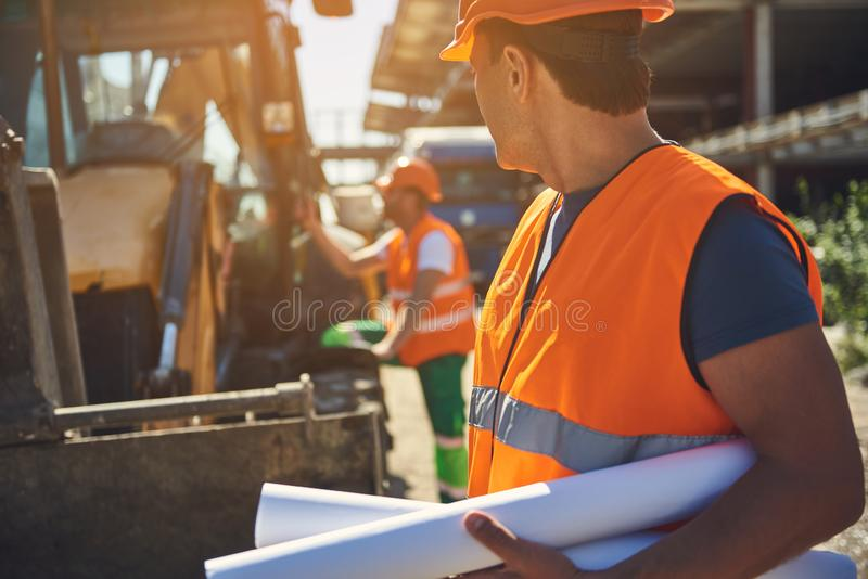 Employees of construction company are working outdoor royalty free stock photography