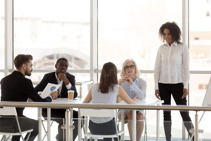 Employees discuss project at company business briefing stock image