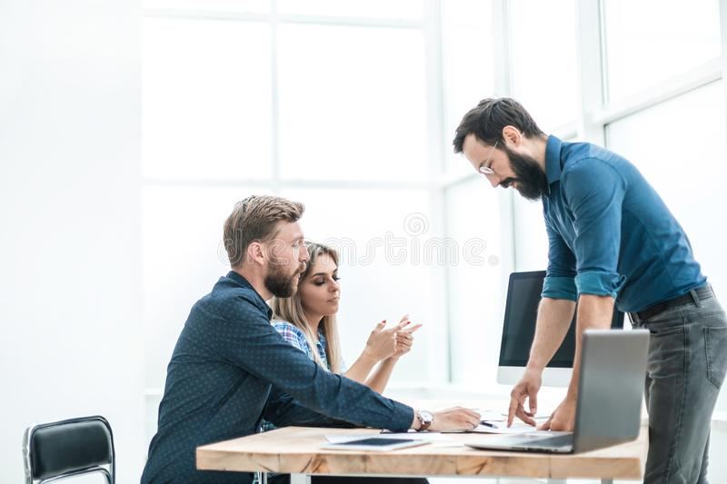 Employees discuss something with a visitor to the Agency royalty free stock images