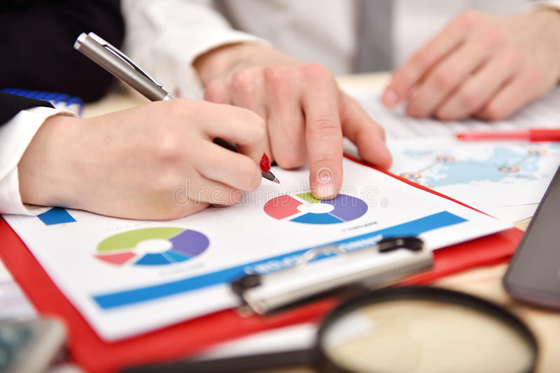Employees discussing business chart in office stock photo