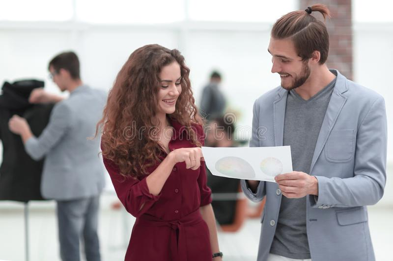 Employees discussing the document in a creative office stock images
