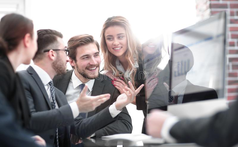 Employees discussing financial profit ,. Sitting at their Desk in the office stock photography