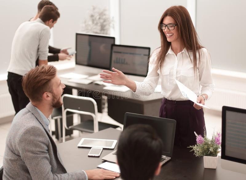Employees discussing new ideas. stock photos