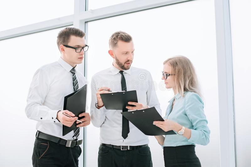 Employees discussing the work plan before starting a business seminar. Business concept royalty free stock photos