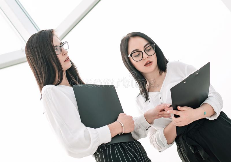Employees discussing the work plan before starting a business seminar. Business concept stock image