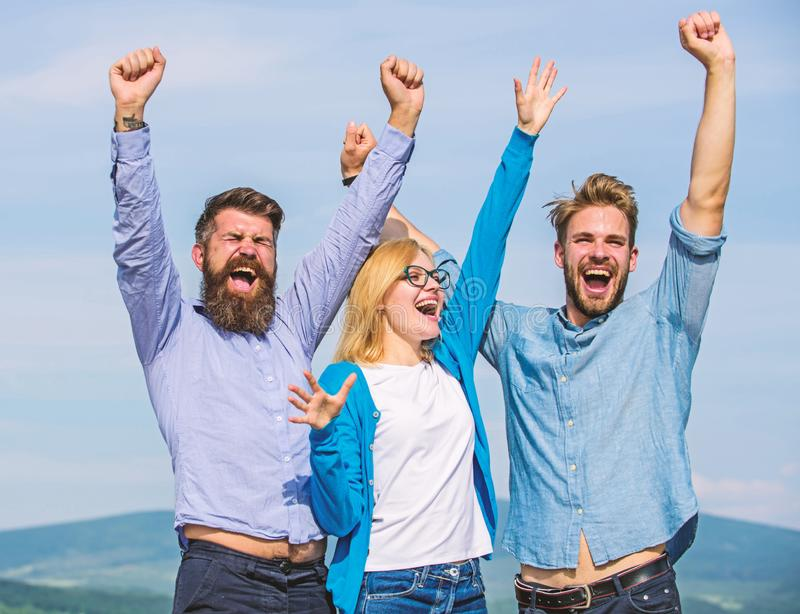 Employees enjoy feeling of freedom. Freedom concept. Company three happy colleagues office workers enjoy freedom, sky stock photography