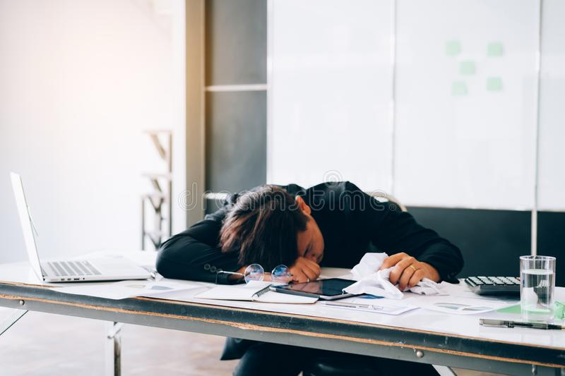 Employees are feeling tired while working.  stock photos