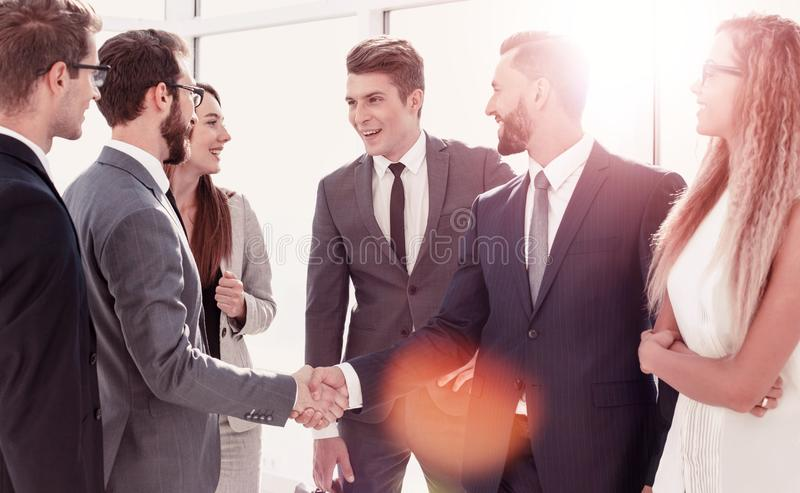 Employees greet each other with a handshake royalty free stock images