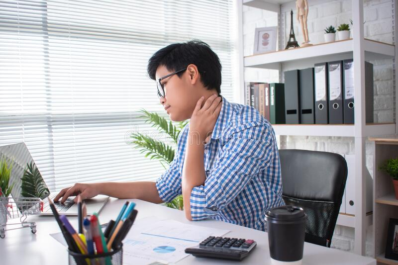 Employees have a problem with any part of the torso, arms, shoulders, neck, back and head. From working hard in the office.  royalty free stock photography