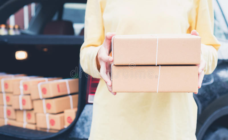 Employees are holding a parcel in the car to send to the customer. Online ordering For the convenience of customers. stock photos