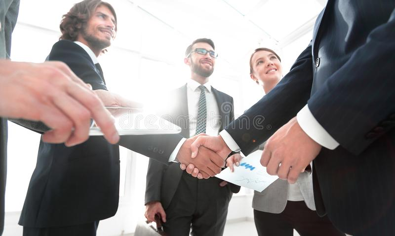 Employees look at the handshake business partners. The concept of teamwork royalty free stock photos