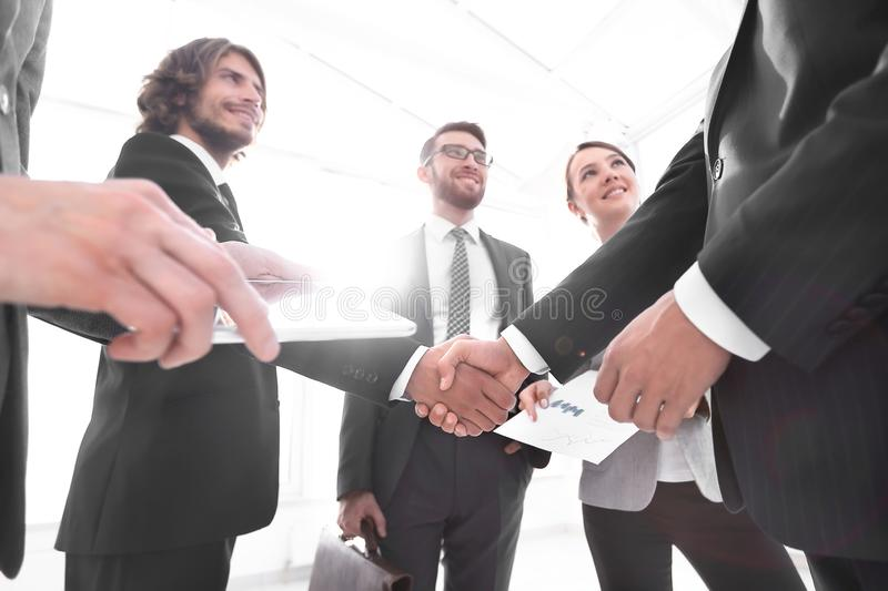 Employees look at the handshake business partners. The concept of teamwork royalty free stock photography
