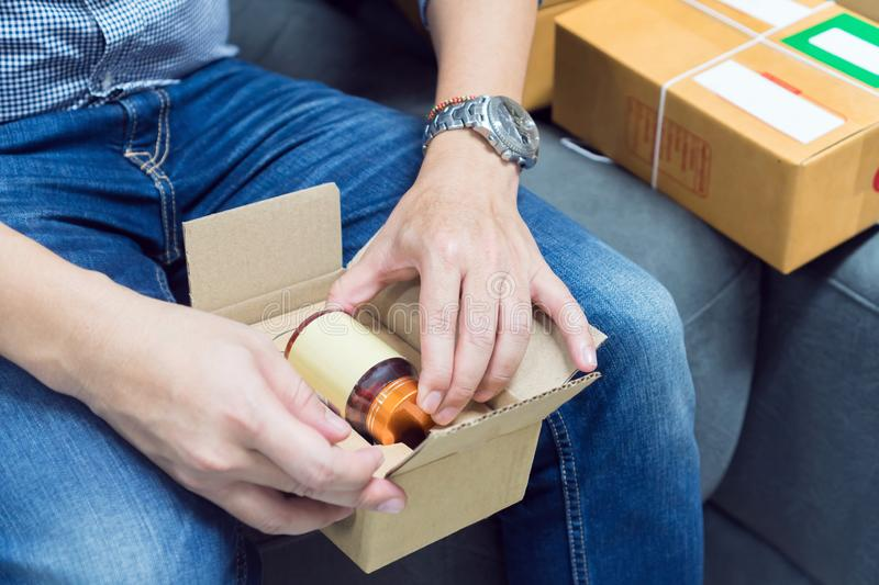 Employees are packing a parcel in the send to the customer. stock images