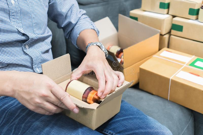 Employees are packing a parcel in the send to the customer. Online ordering For the convenience of customers. royalty free stock photo