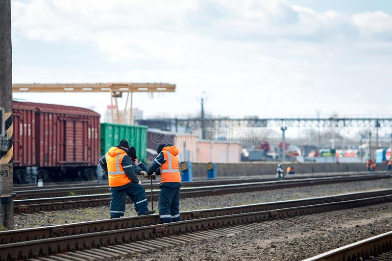 Employees of railway depot inspect repair and maintenance of railway rails in order to detect breakdowns and ensure safety of royalty free stock images