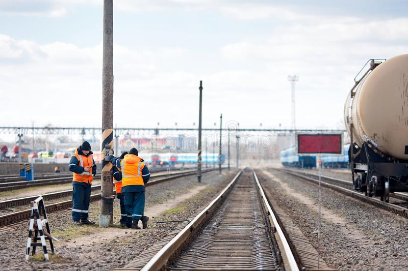Employees of the railway depot make breaks in the work for recreation, while inspecting repairing railway rails in order to detect royalty free stock photos