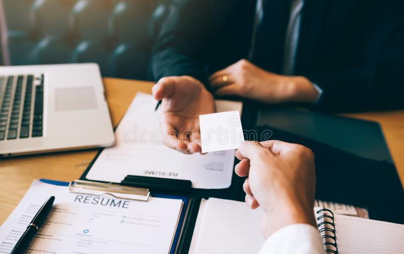 Employees submit business cards to job interviewers and interested in joining him contact immediately.  stock photo