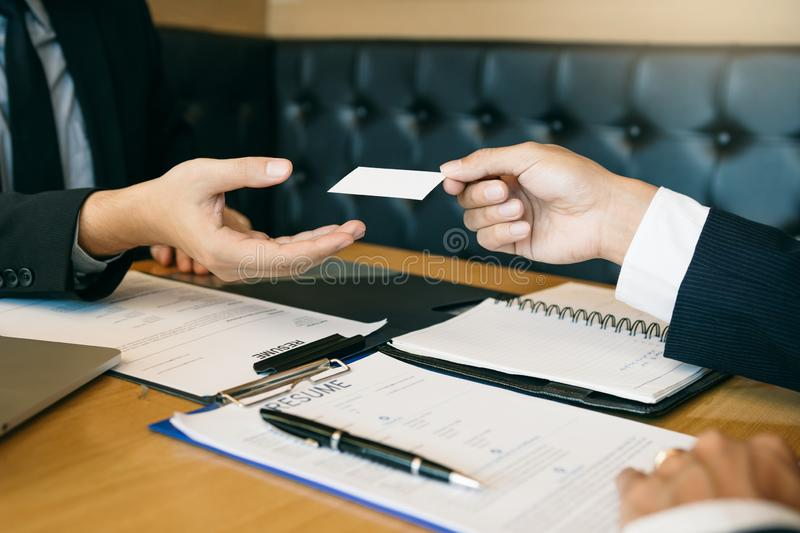 Employees submit business cards to job interviewers and interested in joining him contact immediately.  stock images