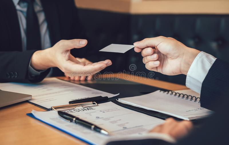 Employees submit business cards to job interviewers and interested in joining him contact immediately.  royalty free stock images