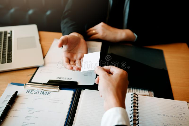 Employees submit business cards to job interviewers and interested in joining him contact immediately.  royalty free stock image