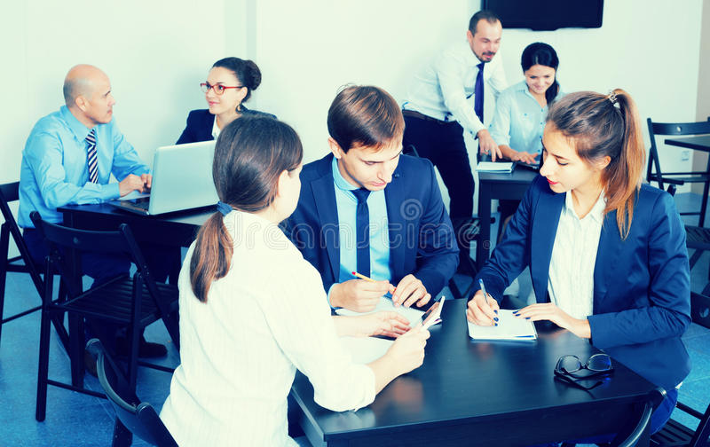 Employees talking about business project in office stock photography
