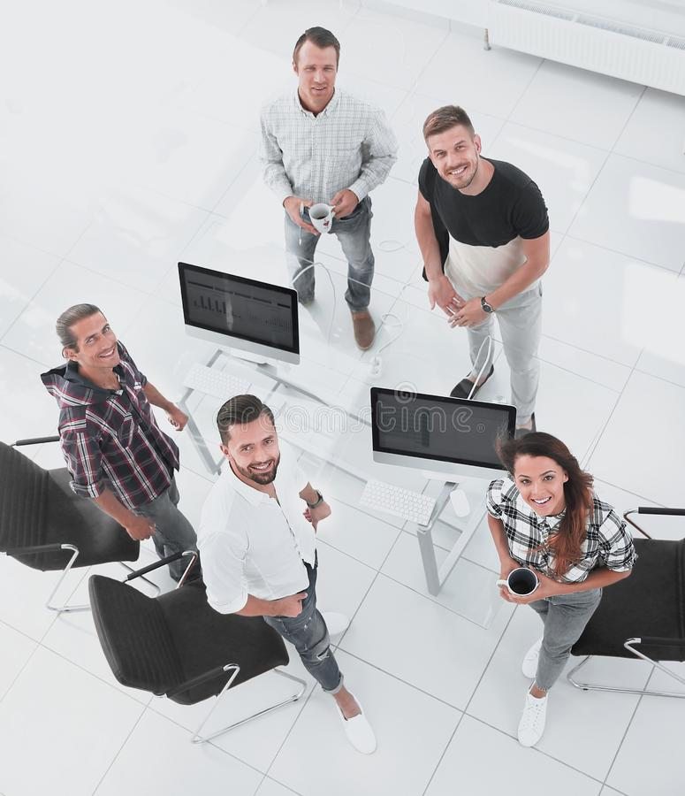 Employees of travel agencies standing in office stock photo