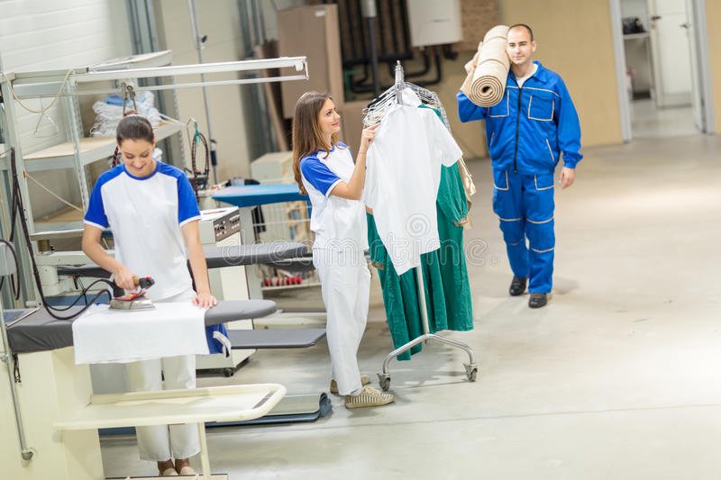 Employees working. I in laundry service royalty free stock photography